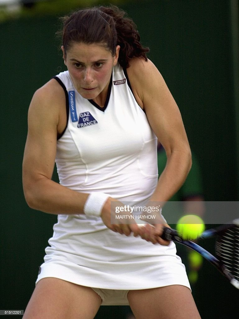 Dechy France  city photos : French Nathalie Dechy plays a backhand during her second round match ...