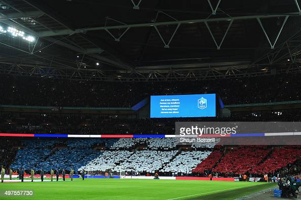 French national anthem lyrics is displayed while the national flag is formed prior to the International Friendly match between England and France at...