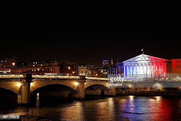 French National Assembly is illuminated in Red White and Blue in honour of the victims of Friday's terrorist attacks on November 18 2015 in Paris...