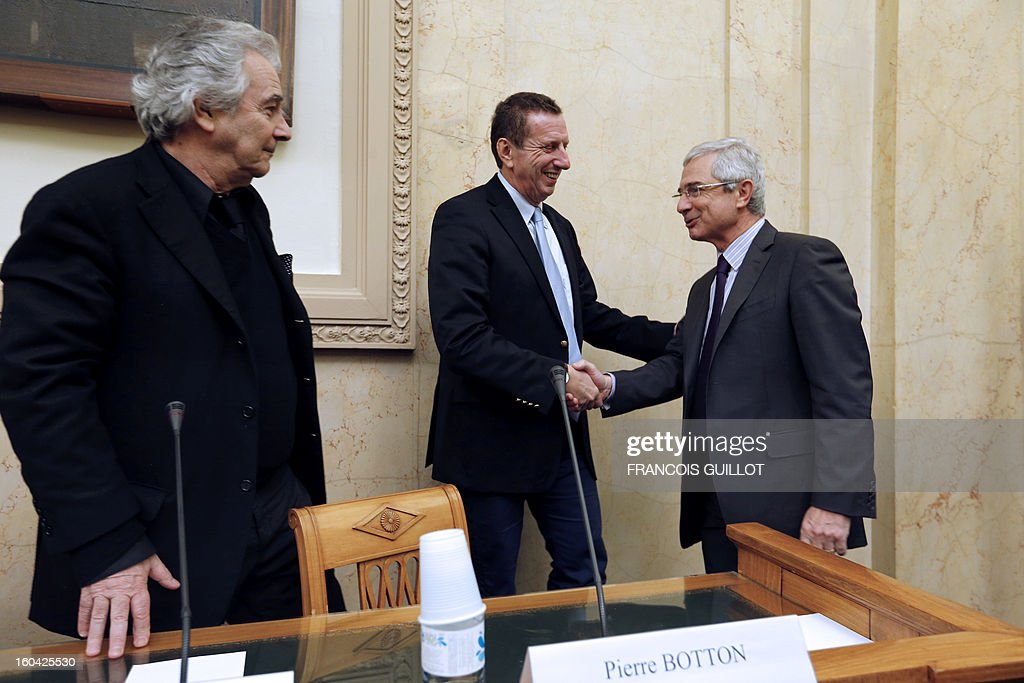 French National Assembly President, Claude Bartolone (R) shakes hands with Pierre Botton, founder of the association 'Les Prisons du Coeur' (Prisons of Heart), an association to raise public awareness against repeat offence as French actor Pierre Arditi, looks on, on January 31, 2013 at the French National Assembly where they present a law to authorize journalists to accompany parliamentarians during their unannounced visits to prisons.