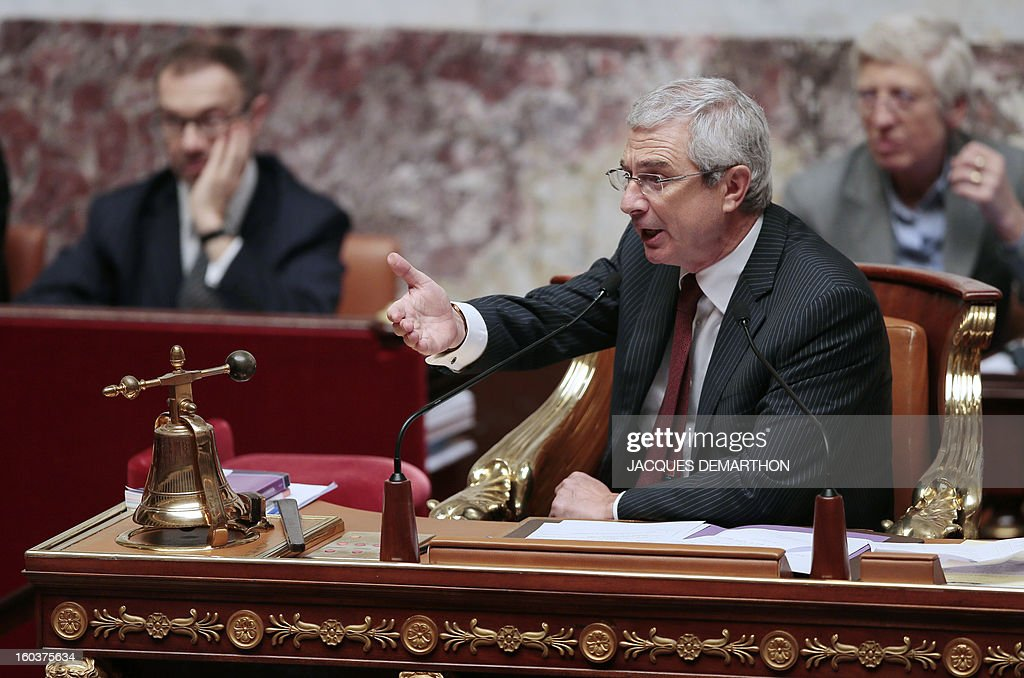 French National Assembly President Claude Bartolone tries to calm down the opposition party during a session of questions to the government at the National Assembly on January 30, 2013 in Paris.