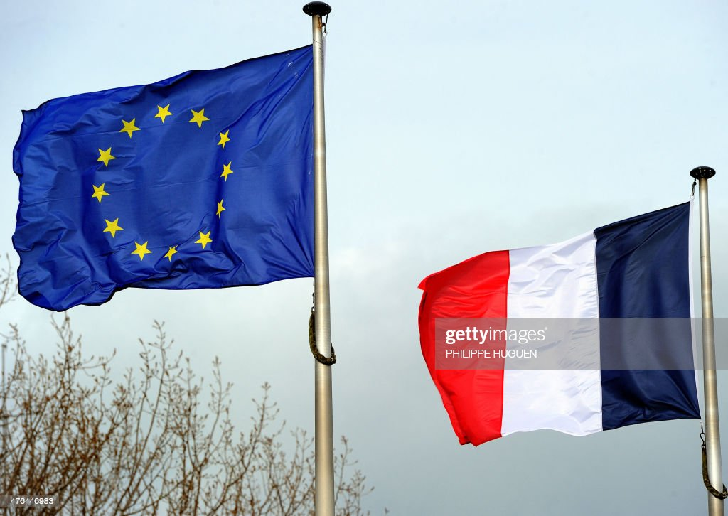 A French national flag (L) and an European Union flag are pictured in Dunkerque, northern France, on March 2, 2014.