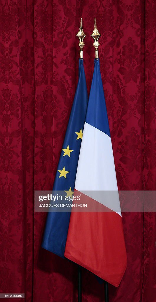 French national flag and European Union flag are pictured on February 22, 2013 during an awarding ceremony at the Elysee Presidential Palace in Paris.