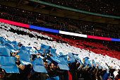 French national flag is formed prior to the International Friendly match between England and France at Wembley Stadium on November 17 2015 in London...