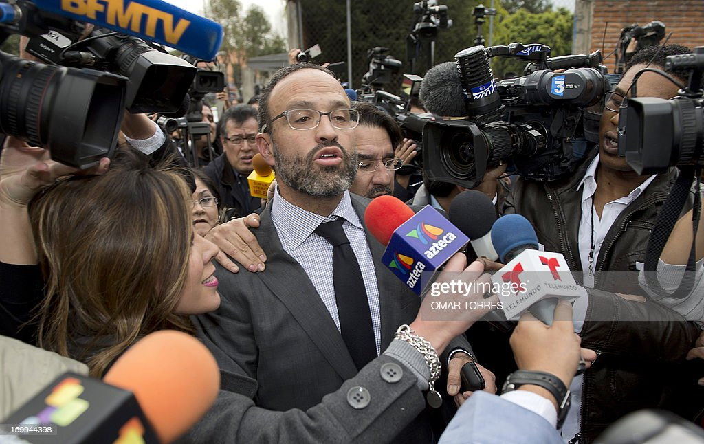 French national Florence Cassez's attorney Agustin Acosta (C) arrives at Tepepan prison in Mexico City on January 23, 2013. Mexico's Supreme Court ordered Wednesday the immediate release of a French woman serving 60 years in prison for kidnapping, ruling that police violated her rights by staging her arrest on national television.