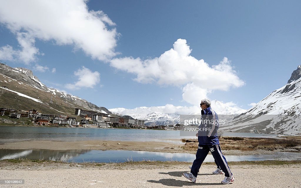 French national football team coach Raymond Domenech walks during a training session on May 21, 2010 in Tignes' lake, French Alps, as part of their preparation for the upcoming World Cup 2010 in South Africa. France will play Uruguay in Capetown in its group A opener match next June 11.