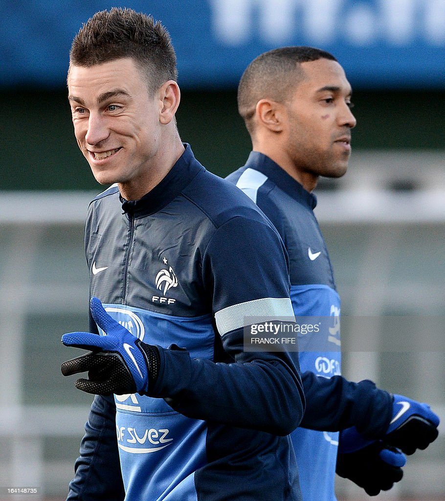 French national football team defender Laurent Koscielny (L) and defender Gael Clichy take part in a training session in Clairefontaine-en-Yvelines, near Paris on March 20, 2013, two days ahead of a World Cup 2014 qualifying football match against Georgia to be held at the stade de France in Saint-Denis, north of Paris. AFP PHOTO / FRANCK FIFE
