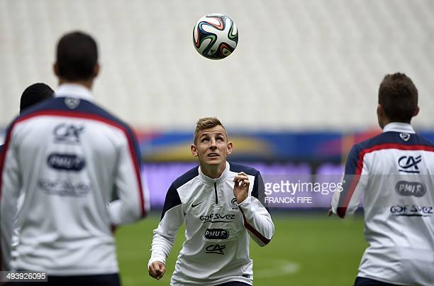 French national football team defender Lucas Digne looks at the ball during a training session on May 26 on the eve of his team's friendly football...