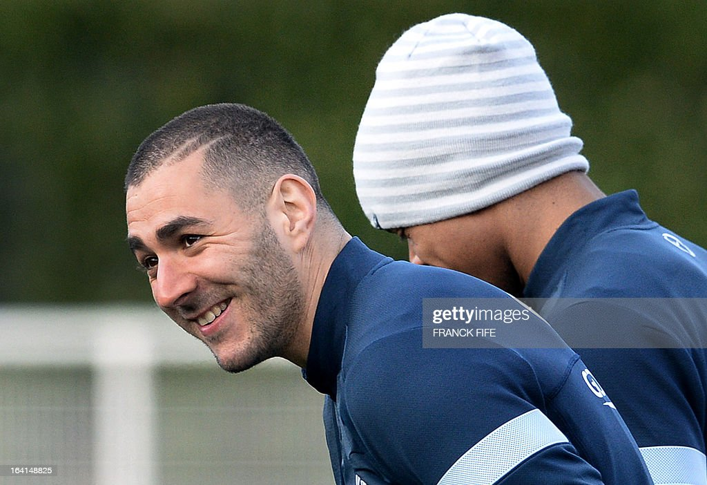French national football team forward Karim Benzema smiles during a training session in Clairefontaine-en-Yvelines, near Paris, on March 20, 2013, two days ahead of a World Cup 2014 qualifying football match against Georgia to be held at the stade de France in Saint-Denis, north of Paris.