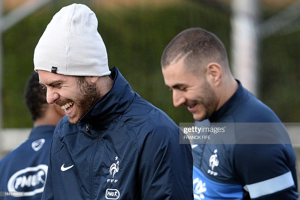 French national football team forwards Jeremy Menez (L) and Karim Benzema smile during a training session in Clairefontaine-en-Yvelines, near Paris, on March 20, 2013, two days ahead of a World Cup 2014 qualifying football match against Georgia to be held at the stade de France in Saint-Denis, north of Paris. AFP PHOTO / FRANCK FIFE