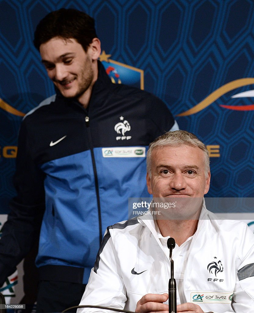 French national football team goalkeeper Hugo Lloris (L) leaves a press conference behind head coach Didier Deschamps on March 21, 2013, in Saint-Denis, north of Paris, on the eve of their FIFA World Cup 2014 qualifying football match France vs Georgia at the Stade de France in Saint-Denis.