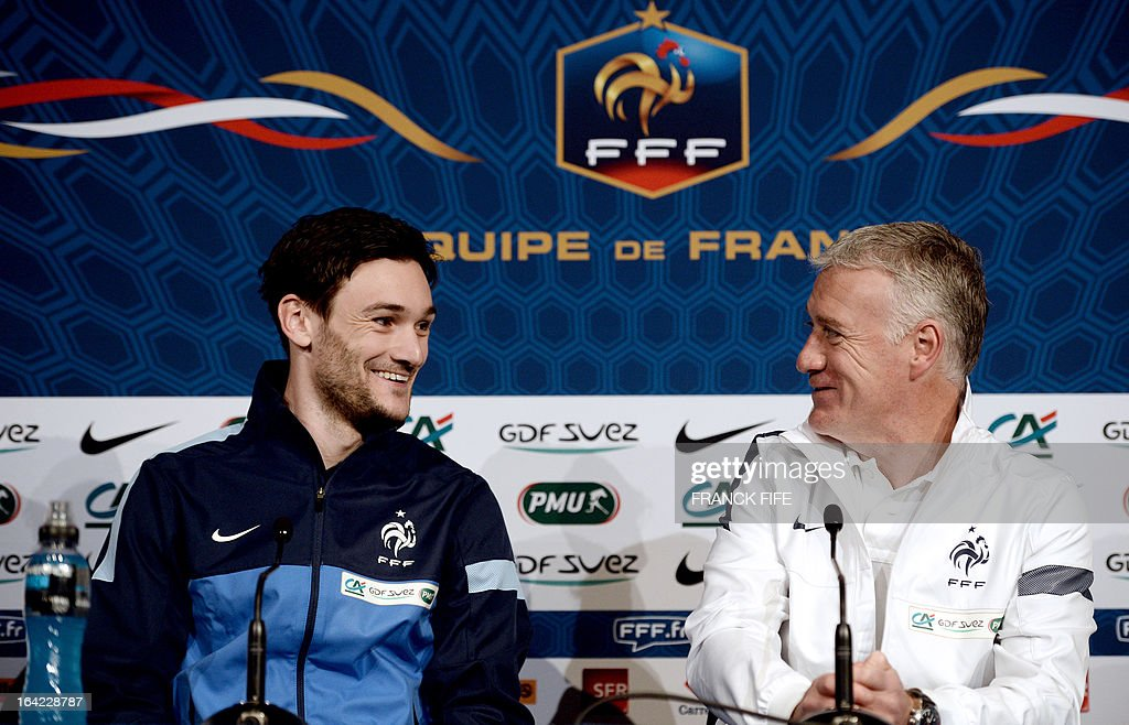 French national football team head coach Didier Deschamps (R) and goalkeeper Hugo Lloris look at each other as they give a press conference on March 21, 2013, 2013 in Saint-Denis, north of Paris, on the eve of a World Cup 2014 qualifying football match France vs Georgia at the Stade de France in Saint-Denis.