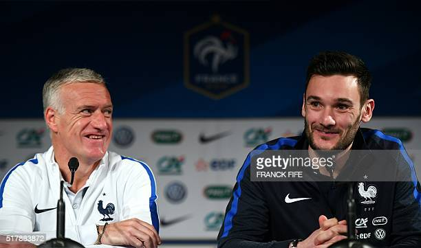 French national football team head coach Didier Deschamps and the team's goalkeeper and captain Hugo Lloris give a press conference at the Stade de...