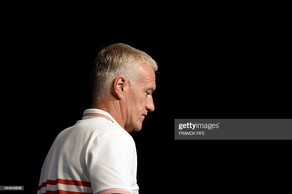 French national football team head coach Didier Deschamps leaves a press conference on September 3, 2014, on the eve of the team's friendly football match against Spain at the Stade de France in Saint-Denis near Paris.