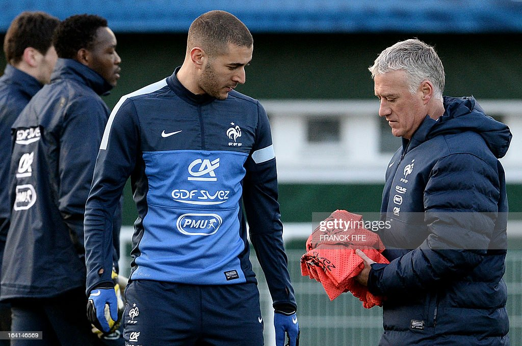 French national football team head coach Didier Deschamps (R) speaks with forward Karm Benzema during a training session in Clairefontaine-en-Yvelines, near Paris, on March 20, 2013, two days ahead of a World Cup 2014 qualifying football match against Georgia to be held at the stade de France in Saint-Denis, north of Paris.