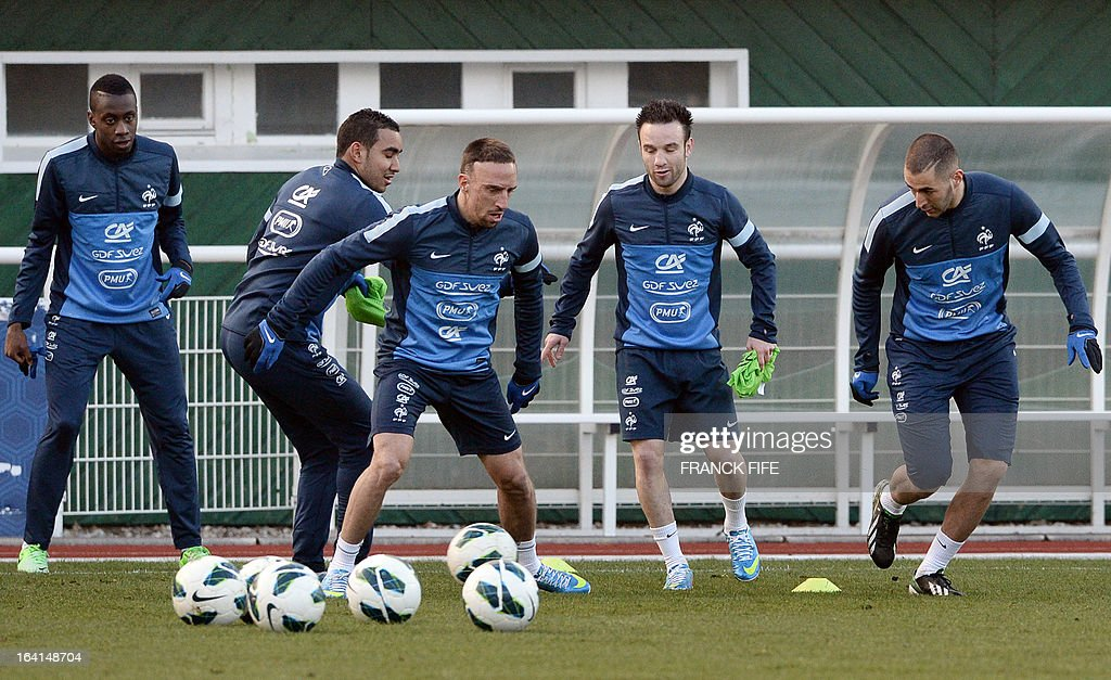 French national football team midfielder Blaise Matuidi, forward Dimitri Payet, forward Franck Ribery, midfielder Mathieu Valbuena and forward Karim Benzema take part in a training session in Clairefontaine-en-Yvelines, near Paris on March 20, 2013, two days ahead of a World Cup 2014 qualifying football match against Georgia to be held at the stade de France in Saint-Denis, north of Paris.