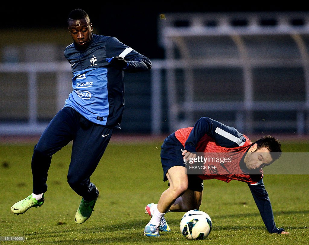French national football team midfielder Blaise Matuidi (L) vies with midfielder Mathieu Valbuena during a training session in Clairefontaine-en-Yvelines, near Paris, on March 20, 2013, two days ahead of a World Cup 2014 qualifying football match against Georgia to be held at the stade de France in Saint-Denis, Paris suburb.