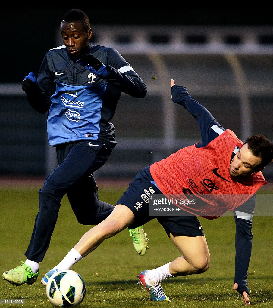 French national football team midfielder Blaise Matuidi (L) vies with midfielder Mathieu Valbuena during a training session in Clairefontaine-en-Yvelines, near Paris, on March 20, 2013, two days ahead of a World Cup 2014 qualifying football match against Georgia to be held at the stade de France in Saint-Denis, Paris suburb. AFP PHOTO / FRANCK FIFE
