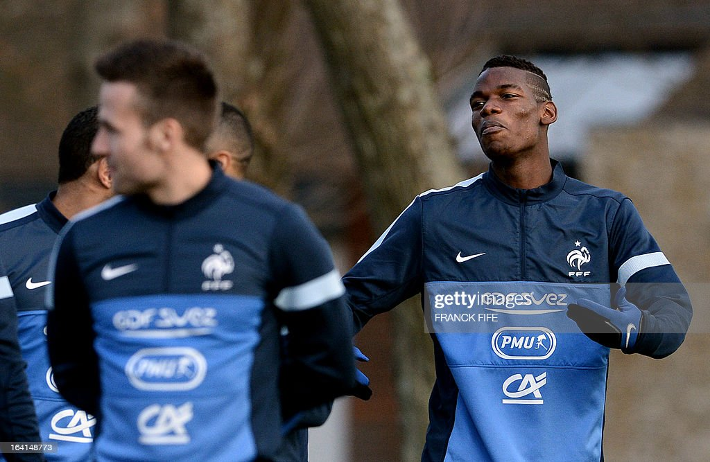 French national football team midfielder Paul Pogba (R) arrives for a training session with teammates in Clairefontaine-en-Yvelines, near Paris, on March 20, 2013, two days ahead of a World Cup 2014 qualifying football match against Georgia to be held at the stade de France in Saint-Denis, north of Paris.