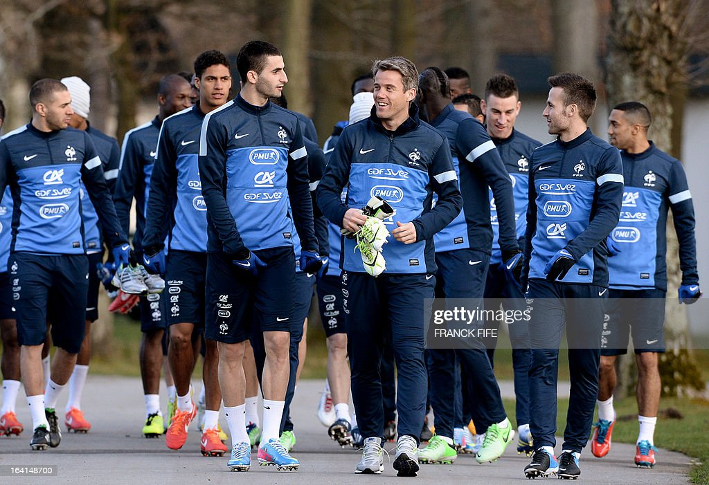 French national football team players arrive for a training session in Clairefontaine-en-Yvelines, near Paris on March 20, 2013, two days ahead of a World Cup 2014 qualifying football match against Georgia to be held at the stade de France in Saint-Denis, north of Paris. AFP PHOTO / FRANCK FIFE