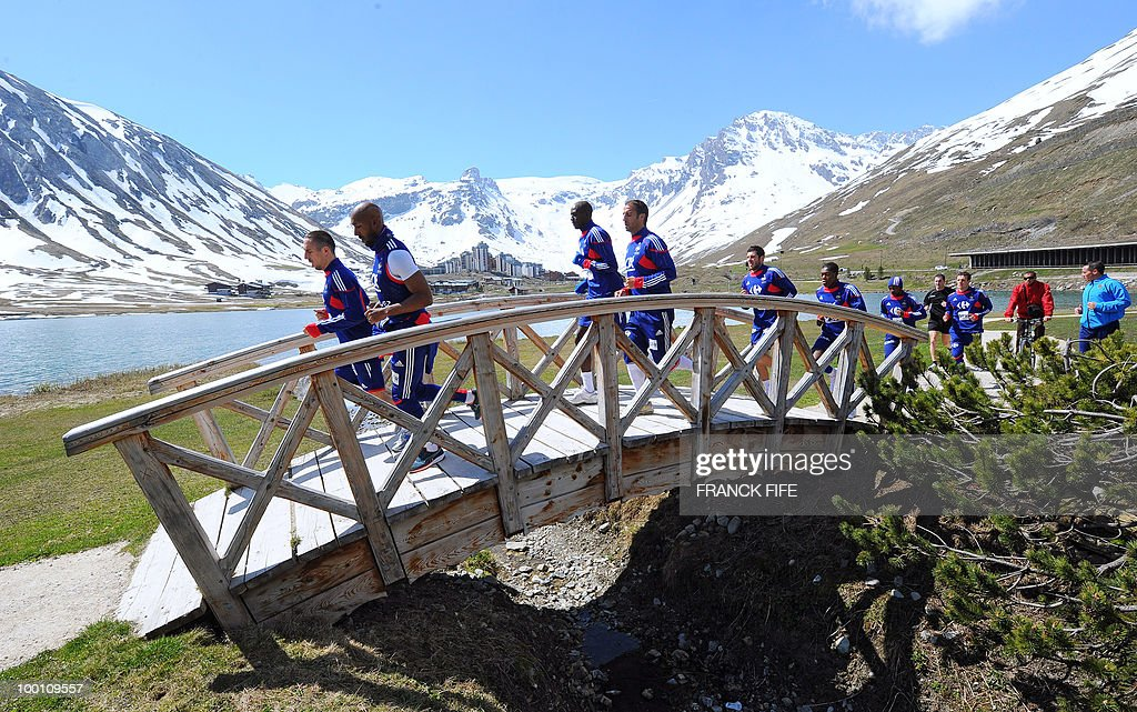 French national football team players jog during a training session on May 21, 2010 around Tignes' lake, in the French Alps, as part of their preparation for the upcoming World Cup 2010 in South Africa. France will play Uruguay in Capetown in its group A opener match next June 11.
