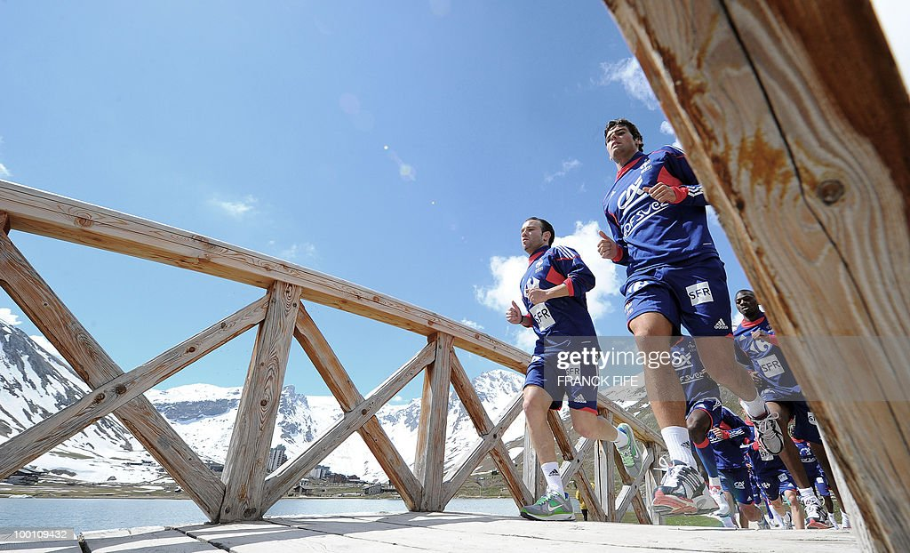French national football team players Mathieu Valbuena (L) and Yoann Gourcuff run with teammates during a training session on May 21, 2010 around Tignes' lake, in the French Alps, as part of their preparation for the upcoming World Cup 2010 in South Africa. France will play Uruguay in Capetown in its group A opener match next June 11.