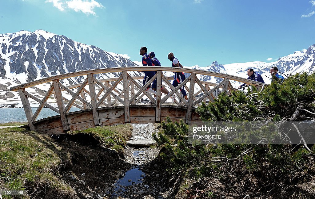French national football team players (From L) Patrice Evra, Sidney Govou and Nicolas Anelka and teammates jog during a training session on May 21, 2010 around Tignes' lake, in the French Alps, as part of their preparation for the upcoming World Cup 2010 in South Africa. France will play Uruguay in Capetown in its group A opener match next June 11.