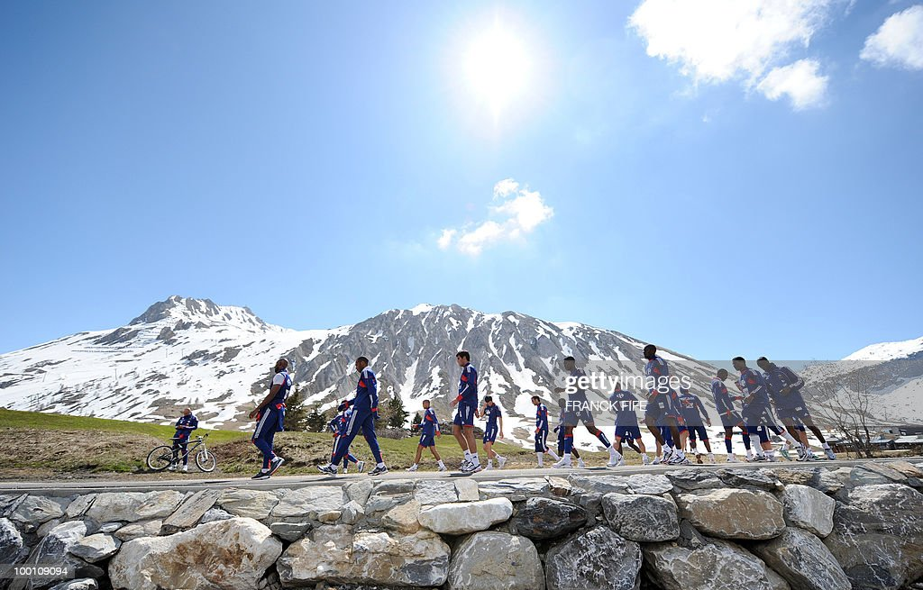 French national football team players run during a training session on May 21, 2010 in Tignes' lake, French Alps, as part of their preparation for the upcoming World Cup 2010 in South Africa. France will play Uruguay in Capetown in its group A opener match next June 11.