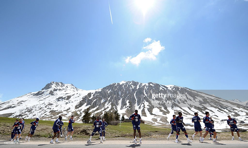 French national football team players run during a training session on May 21, 2010 around Tignes' lake, in the French Alps, as part of their preparation for the upcoming World Cup 2010 in South Africa. France will play Uruguay in Capetown in its group A opener match next June 11.