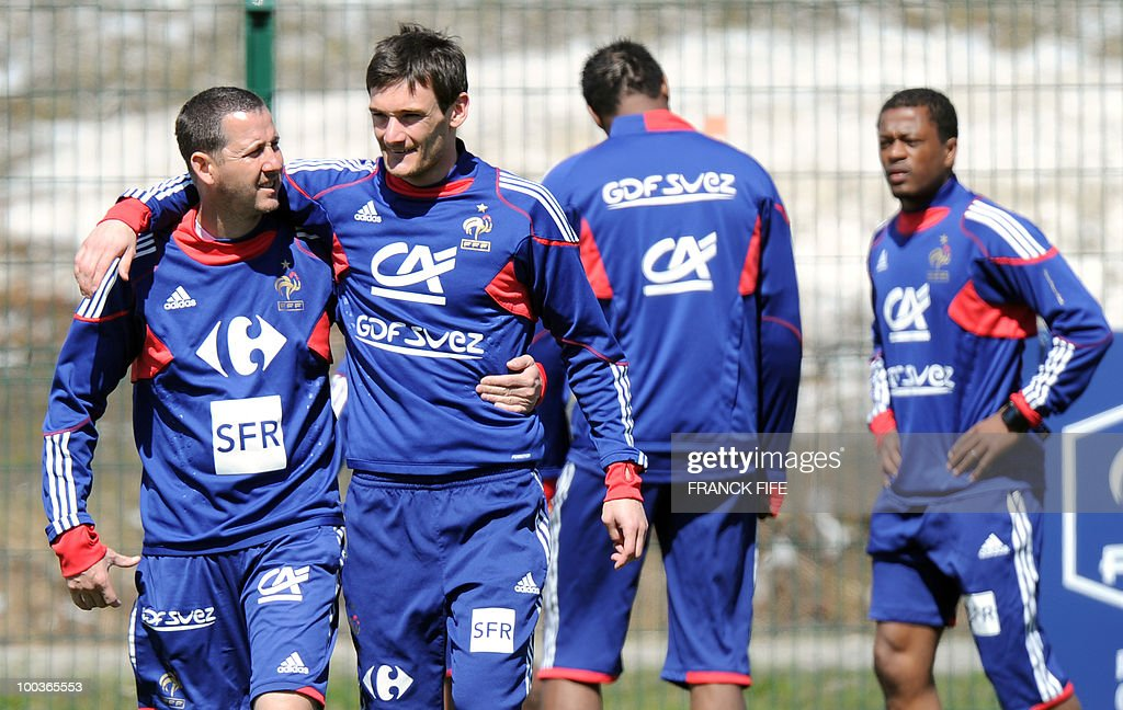 French national football team's assistant coach Fabrice Grange (L) speaks with goalkeeper Hugo Lloris (2nd L) next to Patrice Evra (R) during a training session, on May 24, 2010, near Tignes in the French Alps, as part of the preparation for the upcoming World Cup 2010. France will play against Uruguay in Capetown in its group A opener match on June 11.