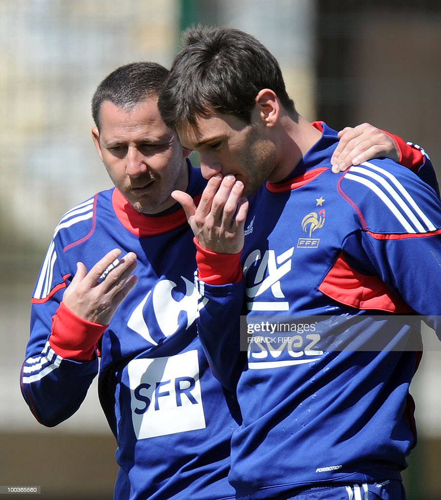 French national football team's assistant coach Fabrice Grange (L) speaks with goalkeeper Hugo Lloris during a training session, on May 24, 2010, near Tignes in the French Alps, as part of the preparation for the upcoming World Cup 2010. France will play against Uruguay in Capetown in its group A opener match on June 11.
