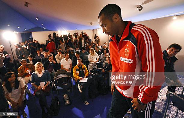 French national football team's captain and forward Thierry Henry leaves a press conference on September 9 2008 in Clairefontaine outside Paris on...