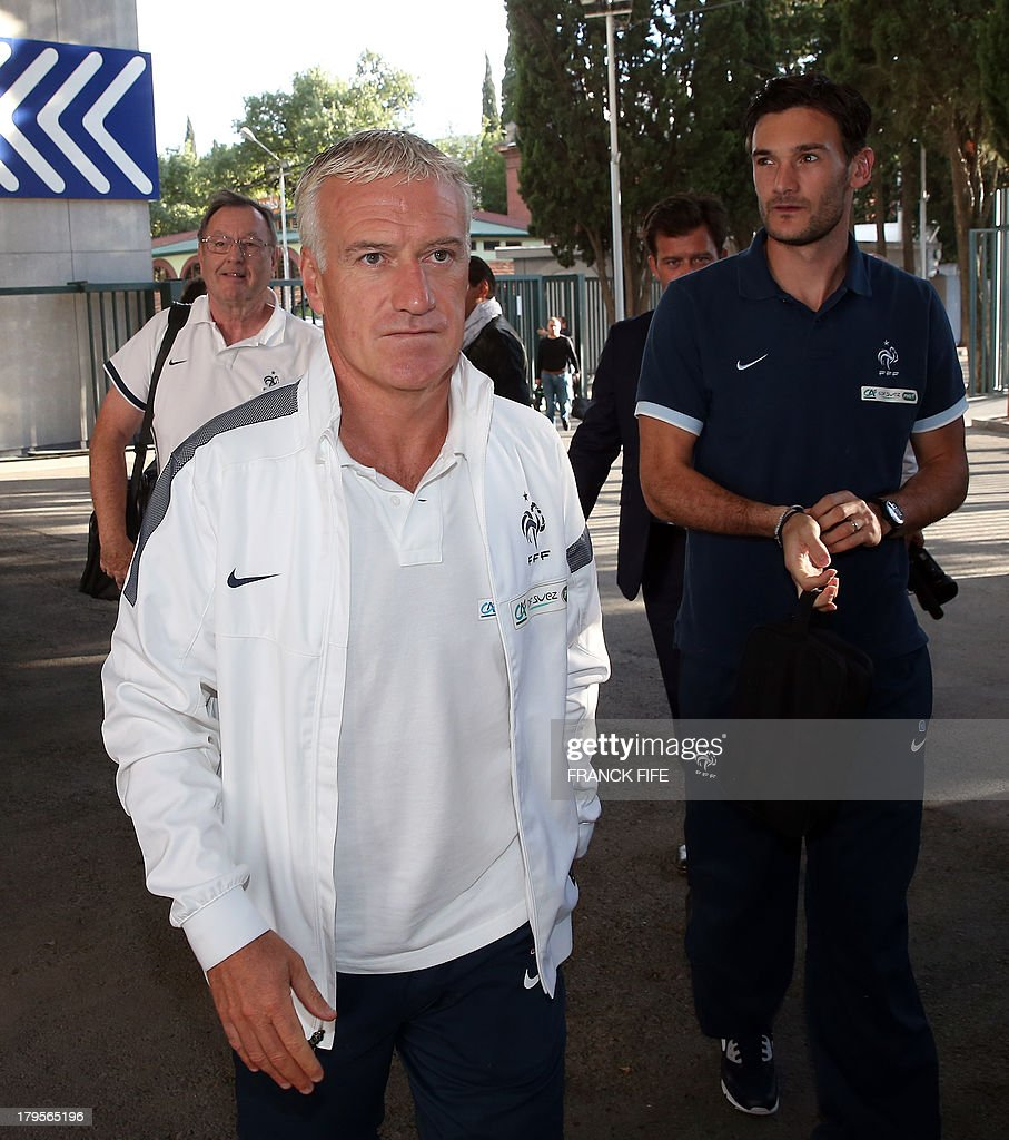 French national football team's captain Hugo Lloris (R) and head coach Didier Deschamps arrive for a press conference on September 5, 2013, on the eve of their FIFA World Cup 2014 qualifying football match Georgia vs France at the Boris Paichadze stadium in Tbilisi.