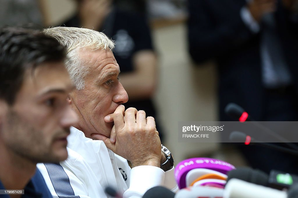 French national football team's captain Hugo Lloris (L) and head coach Didier Deschamps arrive for a press conference on September 5, 2013, on the eve of their FIFA World Cup 2014 qualifying football match Georgia vs France at the Boris Paichadze stadium in Tbilisi.