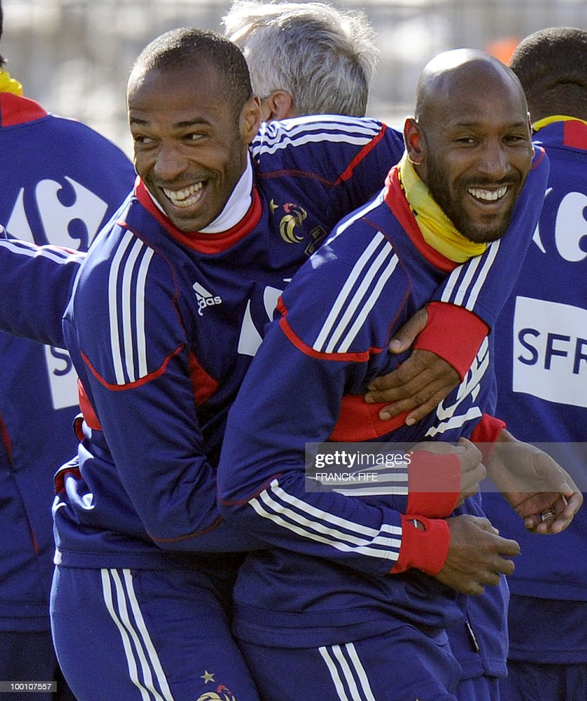 French national football team's captain Thierry Henry (L) jokes with Nicolas Anelka during a training session, on May 20 , 2010 in Tignes, French Alps, as part of their altitude training in preparation for the 2010 World cup in South Africa. France will play Uruguay in Capetown in its group A opener match on June 11.
