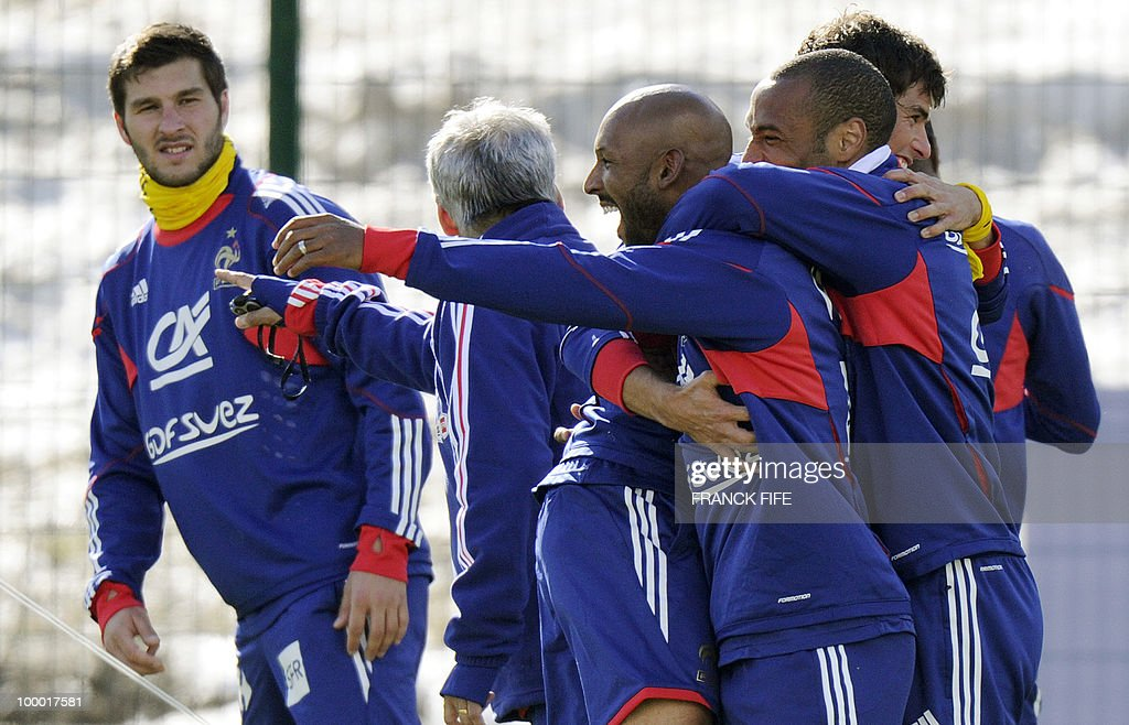 French national football team's captain Thierry Henry (R) jokes with forward Nicolas Anelka (2ndR) next to forward Andre-Pierre Gignac (L) during a training session, on May 20, 2010 in Tignes, French Alps, as part of their altitude training in preparation for the 2010 World cup in South Africa. France will play Uruguay in Capetown in its group A opener match on June 11.