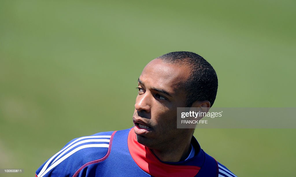 French national football team's captain Thierry Henry takes part in a training session, on May 25, 2010, near Tignes in the French Alps, as part of the preparation for the upcoming World Cup 2010. France will play against Uruguay in Capetown in its group A opener match on June 11.