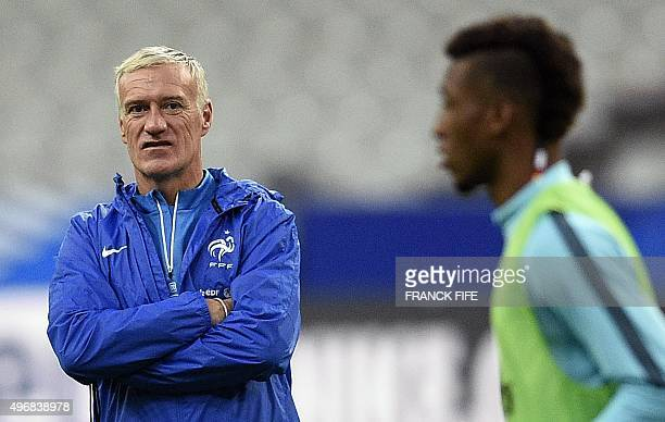 French national football team's coach Didier Deschamps looks on during a training session on November 12 2015 at the Stade de France stadium in...