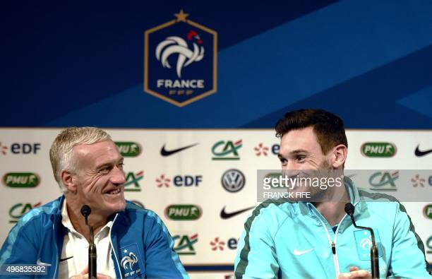 French national football team's coach Didier Deschamps speaks next to French goalkeaper and captain Hugo Lloris during a press conference at the...