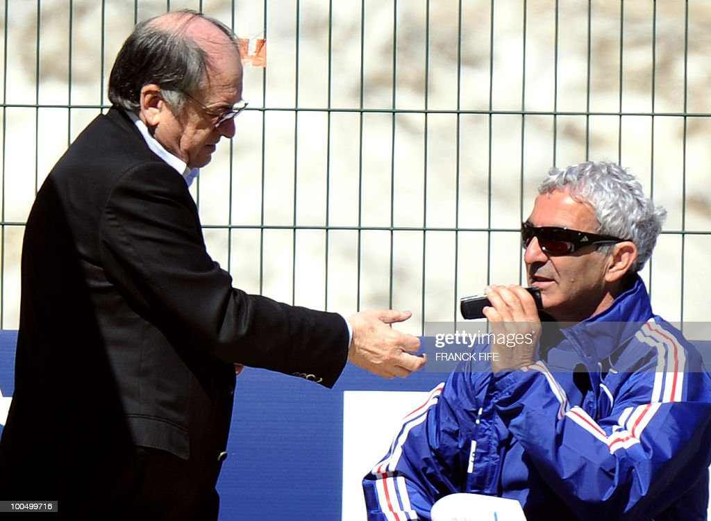French national football team's coach Raymond Domenech (R) and vice-president of French football association Noel Le Graet chat before a training session, on May 24, 2010, near Tignes in the French Alps, as part of the preparation for the upcoming World Cup 2010. France will play against Uruguay in Capetown in its group A opener match on June 11.