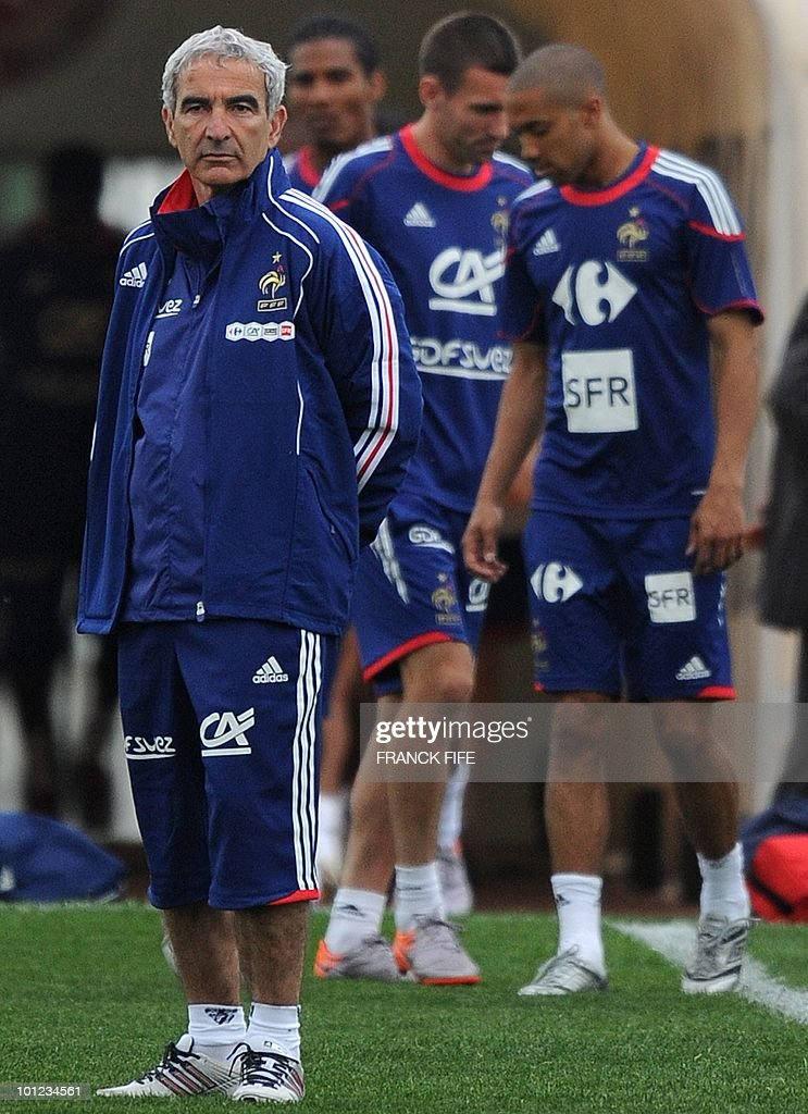 French national football team's coach Raymond Domenech (L) arrives for a training session, on May 28, 2010, in Sousse, as part of the preparation for the upcoming World Cup 2010. France will play against Uruguay in Capetown in its group A opener match on June 11.