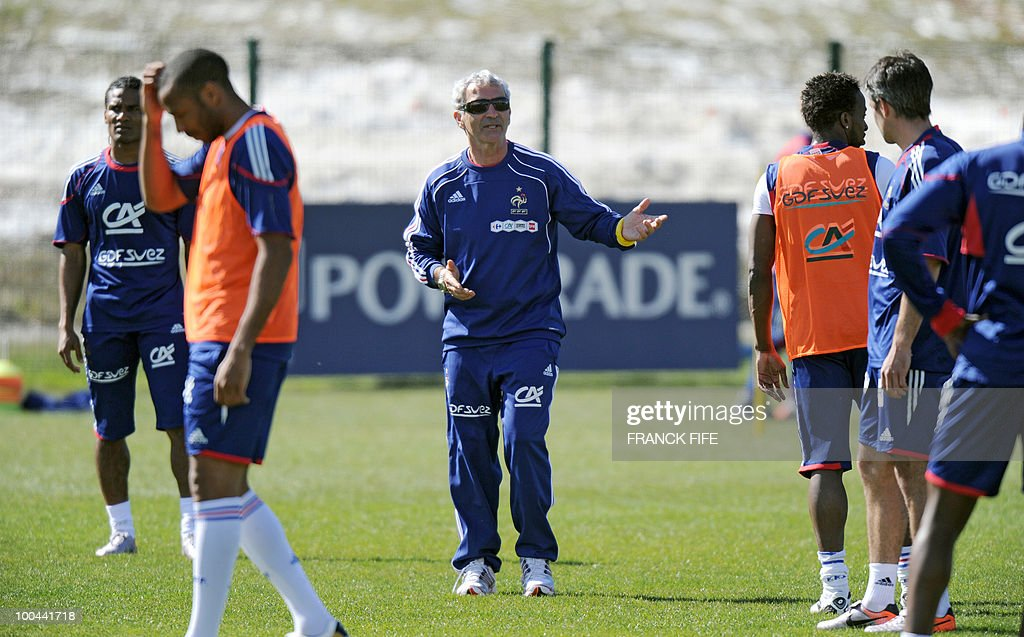 French national football team's coach Raymond Domenech (C) gives instructions to players during a training session, on May 24, 2010, near Tignes in the French Alps, as part of the preparation for the upcoming World Cup 2010. France will play against Uruguay in Capetown in its group A opener match on June 11.