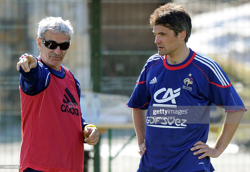 French national football team's coach Raymond Domenech (L) gives instructions to midfielder Jeremy Toulalan (R) during a training session on May 24, 2010, near Tignes in the French Alps, as part of the preparation for the upcoming World Cup 2010. France will play against Uruguay in Capetown in its group A opener match on June 11.
