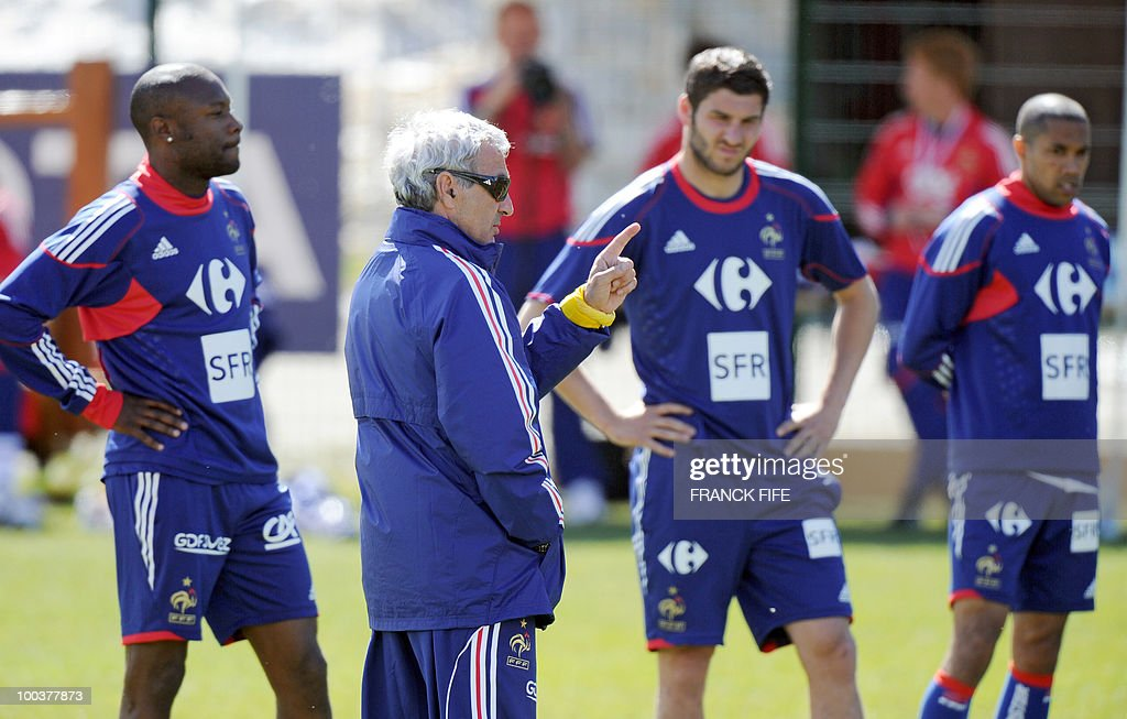 French national football team's coach Raymond Domenech (C) gives instructions to his players during a training session, on May 24, 2010, near Tignes in the French Alps, as part of the preparation for the upcoming World Cup 2010. France will play against Uruguay in Capetown in its group A opener match on June 11.
