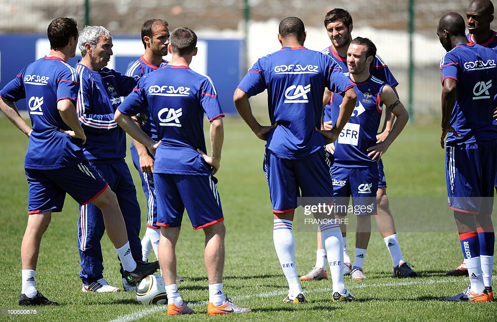French national football team's coach Raymond Domenech (2ndL) gives instructions to his players during a training session, on May 25, 2010, near Tignes in the French Alps, as part of the preparation for the upcoming World Cup 2010. France will play against Uruguay in Capetown in its group A opener match on June 11.