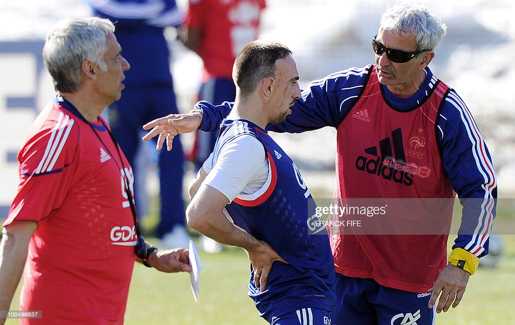 French national football team's coach Raymond Domenech (R) speaks to forward Franck Ribery (C) as coach assistant Pierre Mankowski walks (L) during a training session on May 24, 2010, near Tignes in the French Alps, as part of the preparation for the upcoming World Cup 2010. France will play against Uruguay in Capetown in its group A opener match on June 11.