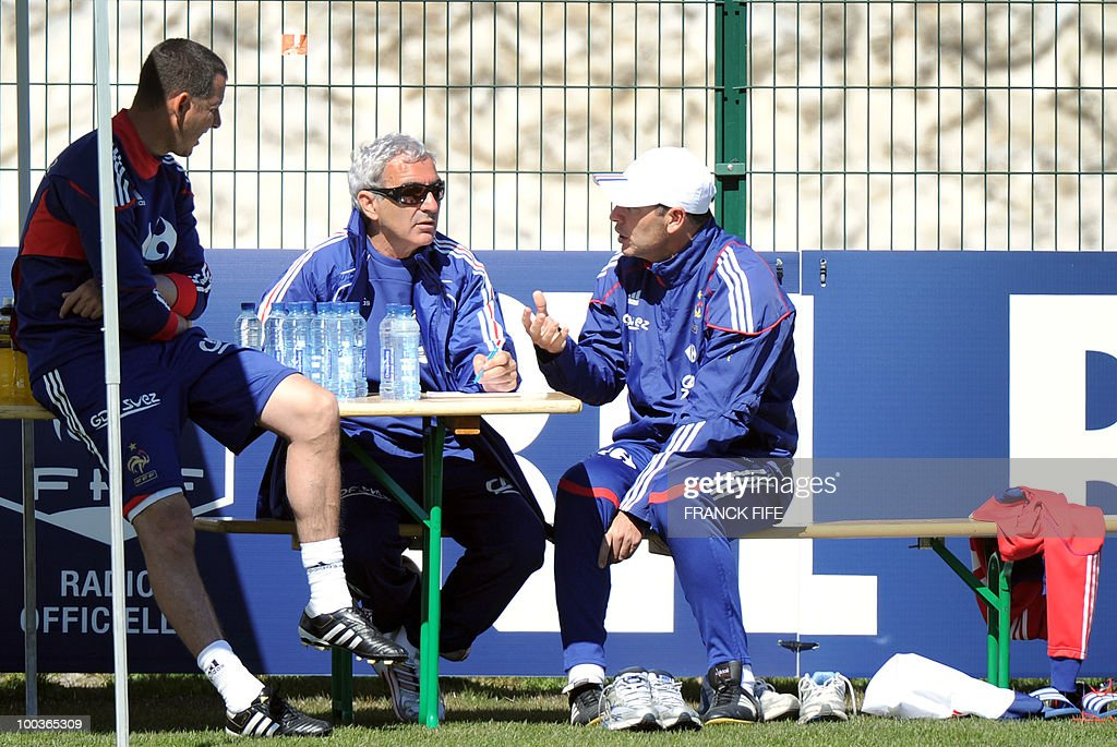 French national football team's coach Raymond Domenech (C) speaks with French physical assistant Robert Duverne (R) and assistant coach Fabrice Grange during a training session, on May 24, 2010, near Tignes in the French Alps, as part of the preparation for the upcoming World Cup 2010. France will play against Uruguay in Capetown in its group A opener match on June 11.