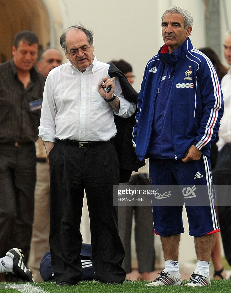 French national football team's coach Raymond Domenech (R) speaks with the vice-president of the French football association, Noel Le Graet, before a training session, on May 28, 2010, in Sousse, as part of the preparation for the upcoming World Cup 2010. France will play against Uruguay in Capetown in its group A opener match on June 11.