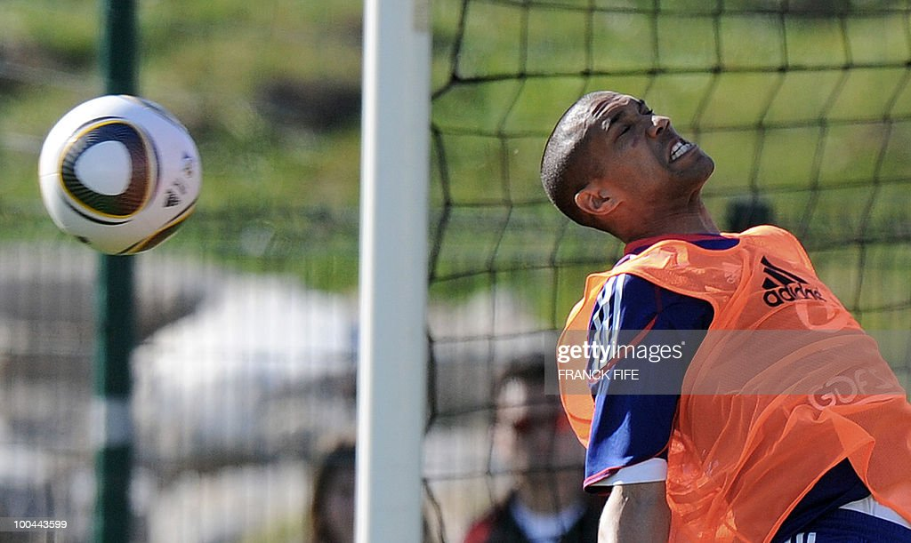 French national football team's defender Gael Clichy heads the ball during a training session on May 24, 2010, near Tignes in the French Alps, as part of the preparation for the upcoming World Cup 2010. France will play against Uruguay in Capetown in its group A opener match on June 11.