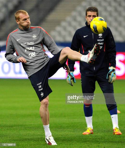 French national football team's defender Jeremy Mathieu juggles with a ball during a training session on November 14 2011 at the Stade de France in...